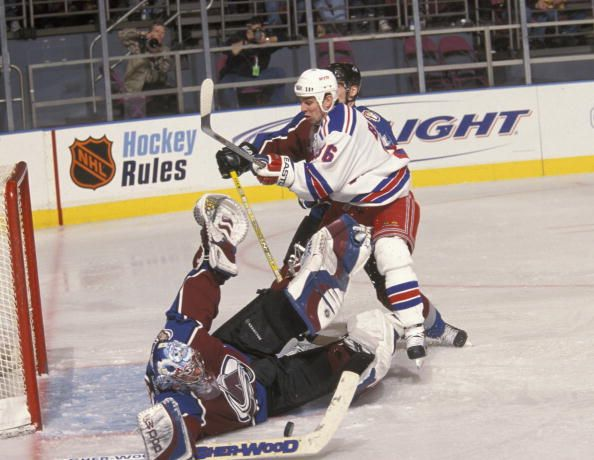 Colorado's Patrick Roy stops Matthew Barnaby of the NY Rangers