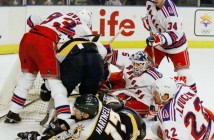 A Mad scramble for the puck buries New York Rangers' goalie