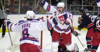 New York Rangers' Eric Lindros (right) celebrates his go-ahe