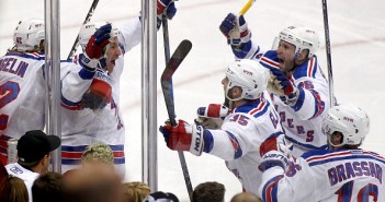 PITTSBURGH, PA - APRIL 22:  Kevin Hayes #13 of the New York Rangers celebrates with Martin St. Louis #26, Tanner Glass #15, Derick Brassard #16 and Carl Hagelin #62 after scoring the game-winning overtime goal in Game Four of the Eastern Conference Quarterfinals against the Pittsburgh Penguins during the 2015 NHL Stanley Cup Playoffs at Consol Energy Center on April 22, 2015 in Pittsburgh, Pennsylvania.  (Photo by Justin K. Aller/Getty Images)