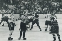 Orland Kurtenbach (25) squares off with Ted Harris (10).