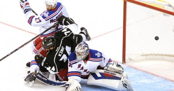 Dwight King bowls over Henrik Lundqvist in Game 2 of the 2014 Cup Final