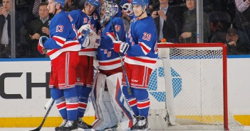 rangers celebrate with Hank