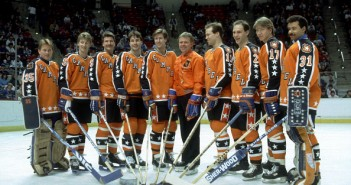 Ten Oilers at the 1986 All-Star game:  (L-R) Goalie Andy Moog #35, Wayne Gretzky #99, Glenn Anderson #9, Paul Coffey #7, Kevin Lowe #4, head coach Glen Sather, Mark Messier #11, Lee Fogolin #2, Jari Kurri #17 and goalie Grant Fuhr #31