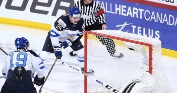 Aleksi Saarela (19) watches as Kasperi Kapanen (24) of Finland scores the winning goal (4-3) in overtime as Finland beats Russia and wins the 2016 IIHF World Junior Ice Hockey Championship.