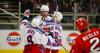 New York Rangers' Eric Lindros is congratulated by teammates