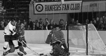 Gordie Howe (9), Harry Howell and Marcel Paille